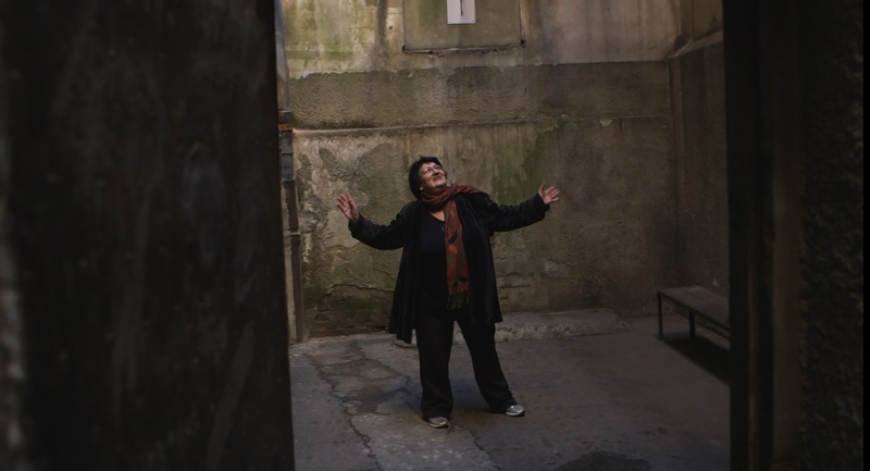 Operation Wedding still of Sylva Zalmanson dancing in the prison yard, in Riga, Lithuania. Credit Andrejs Verhoustin-Co.