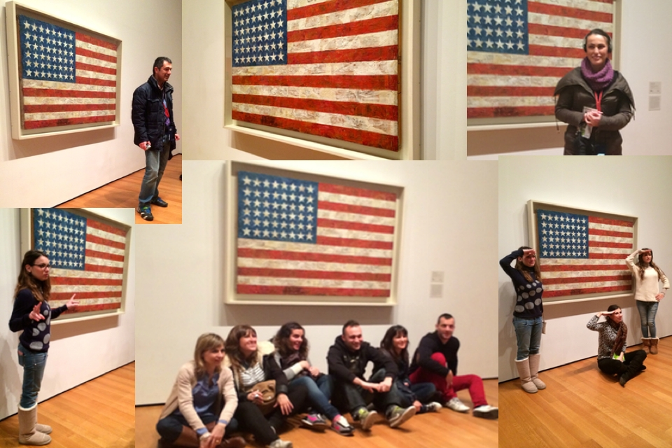 People posing with Jasper Johns flag painting at MOMA