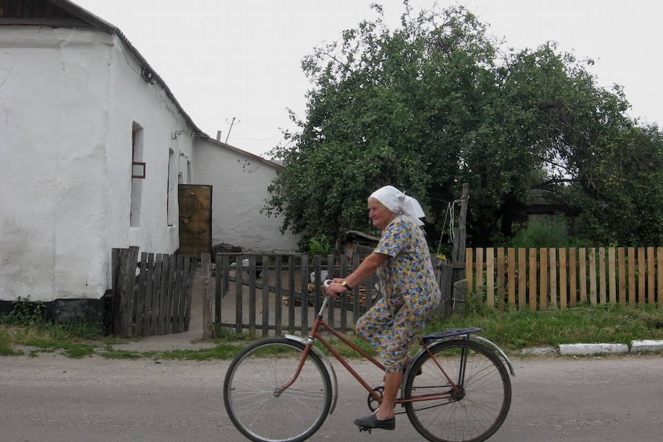 Food poverty and authenticity - woman on a bike in a modern-day shtetl in Ukraine