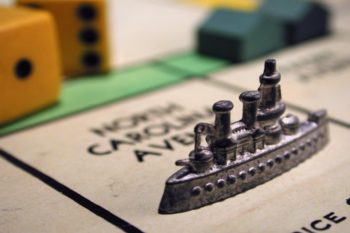 Monopoly ship piece representing teaching history through games