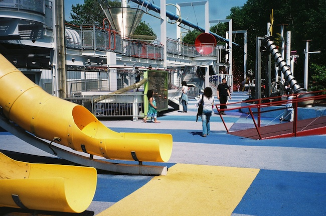 Futuristic-looking playground representing parenting privilege in the workplace