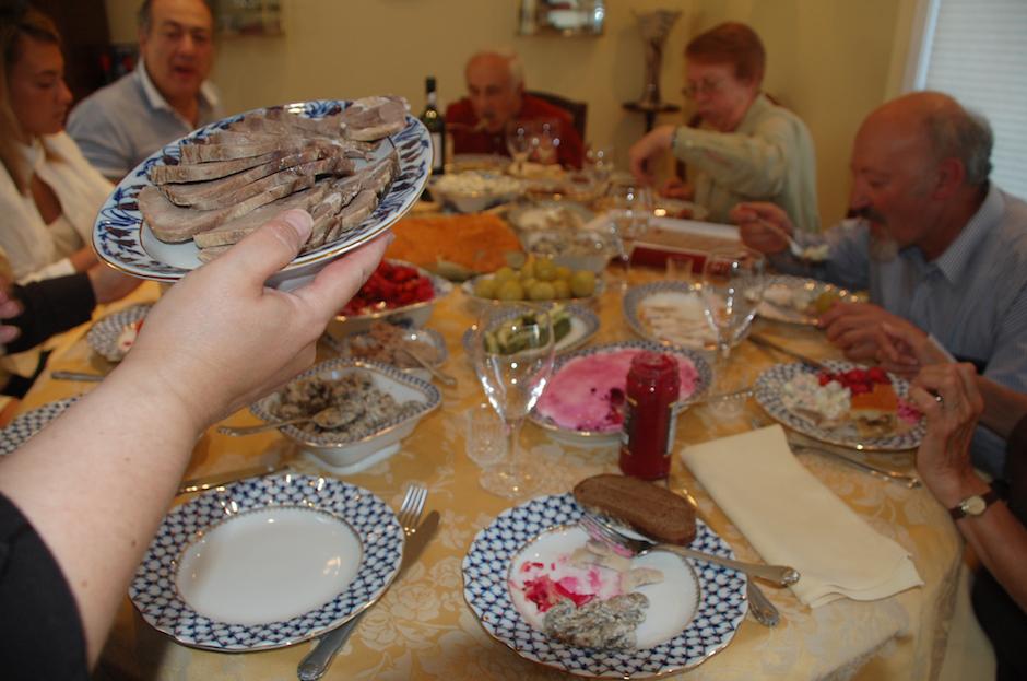 Soviet-era dinner with tongue, shuba (or herring under fur coat), all following Refusenik documentary screening